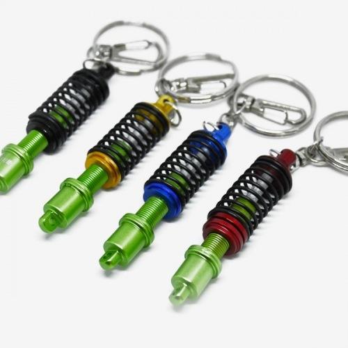Přívěšek na klíče - nastavitelný tlumič zelený s pružinou